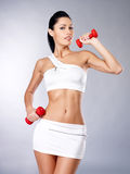 Photo of a healthy training young woman with dumbbells Royalty Free Stock Images