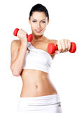 Photo of a healthy training young woman with dumbbells Royalty Free Stock Photo