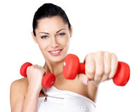 Photo of a healthy training young woman with dumbbells Royalty Free Stock Photos