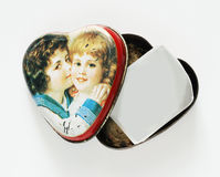 Photo in the heart. In the opened ferrous small box a little photo lies as a heart Royalty Free Stock Image