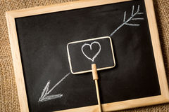 Photo of heart with arrow drawn by chalk on blackboard Royalty Free Stock Images