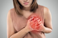 The photo of heart is on the woman `s body, Severe heartache, Hav. Ing heart attack or Painful cramps, Heart disease, Pressing on chest with painful expression stock image
