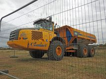 Heavy plant lorries. Photo of heavy plant earthwork earthmovers lorries working on coastline defence measures in whitstable kent oct 2017 Royalty Free Stock Photo
