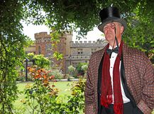 Lord of the manor. Photo of a high society gent lord of the manor posing in the grounds of his stately castle home in kent england royalty free stock images