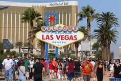 Historic Fabulous Las Vegas Sign. Photo of the historic Welcome to Las Vegas Sign with Mandalay Bay resort and palm trees Stock Photos