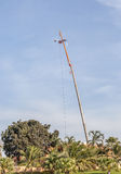 The photo of hoisting crane working for telecommunication site a Stock Image