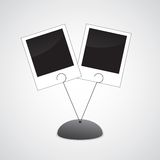 Photo holder with two photos.  Royalty Free Stock Photography