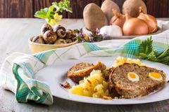 Photo of homemade meatloaf with small quail eggs Royalty Free Stock Photo