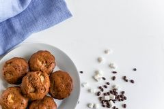 Photo of homemade muffins with bananas. Cooked muffins at home on a white background with a place for an inscription stock photos