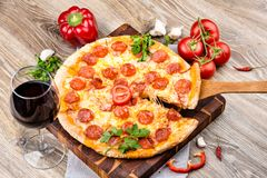 Hot pizza on wooden background Royalty Free Stock Images