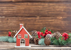 Photo of house shaped toy near christmas decorations  Stock Photos