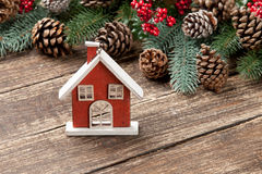 Photo of house shaped toy near christmas decorations  Royalty Free Stock Images