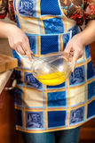 Photo of housewife whisking egg yolk in glass bowl Royalty Free Stock Image