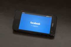 Photo of a HTC Desire device, Logging out from Facebook Stock Photo