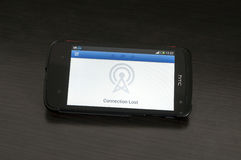 Photo of a HTC Desire device, showing the Connection Lost logo Stock Photography