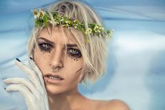Beautiful female portrait with white flag. Royalty Free Stock Photography