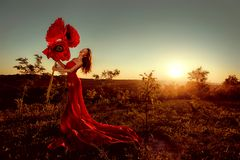 Beautiful female portrait with big paper flowers in the sunset. royalty free stock photography