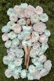 Beautiful female portrait with big white paper flowers. Stock Images