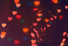 Photo of Illuminated Hearts Around the Light Bulb Stock Photography