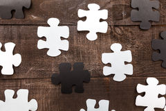 Photo illustration business goals. Photo illustration showing the business concept of engineering applied to industries or internet with puzzle pieces Royalty Free Stock Image