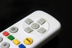 Photo Illustration for Controlling Something, Close Up Remote Control at Black Background stock photos