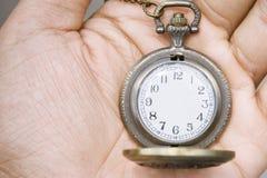Pocket watch. On hand Stock Photos