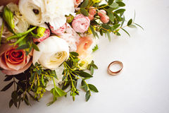 Photo image of a classic wedding gold rings of the bride and groom on a white table Royalty Free Stock Photography
