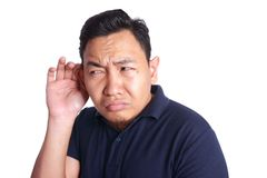 Asian Man Listening Carefully  over white background Royalty Free Stock Images