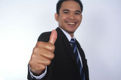 Photo image of a handsome attractive young Asian businessman with thumb up hand. Isolated on white Royalty Free Stock Image