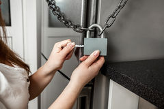 Photo of image hanging lock on refrigerator Stock Photography