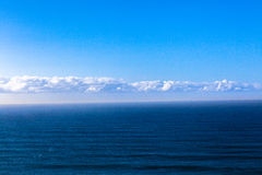 Ocean Blue Swells Clouds Horizon. Photo image overlooking the ocean and blue sky and clouds above the sea ocean swells Royalty Free Stock Photo