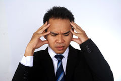 Photo image of young asian businessman headache isolated on white. Photo image of young asian businessman headache Royalty Free Stock Photography