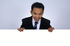 Photo Image of young asian businessman holding a blank sign. Young asian businessman holding a blank sign Stock Photos