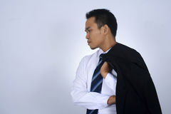 Photo image of young asian businessman holding his suit jacket on his shoulder isolated on white. Photo image of young asian businessman holding his suit jacket Royalty Free Stock Photography