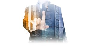 Photo of an index finger of a successful businessman in a suit and office buildings, skyscrapers of a city a double exposition. To Royalty Free Stock Photos