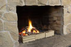 Photo of an indoor brick fireplace Royalty Free Stock Photos