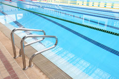 Photo of Indoor swimming pool with sunny reflections Stock Image