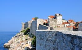 Climbing the city walls, next to the sea royalty free stock photos
