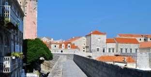 Cross the city through the walls. Photo of the inner part of Dubrovnik walls and the  city - Dubrovnik -  Croatia - July 2010 Stock Photo