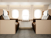 Photo interior of luxury private airplane. Empty leather chair, modern generic design laptop table. Image ready for your. Business information. Horizontal Stock Images