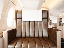 Photo interior of luxury private airplane. Empty leather chair, sunlight. Blank white frame ready for your business Royalty Free Stock Photo