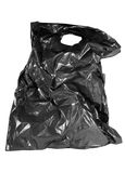 Photo of isolated old black plastic bag. Royalty Free Stock Photo