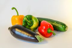 Isolated ratatouille ingredients - peppers, eggplant, zucchini royalty free stock photos