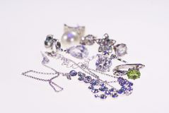 Photo of jewelery earrings and chains. Photo jewelry. rings of earrings and chains on a light background stock images