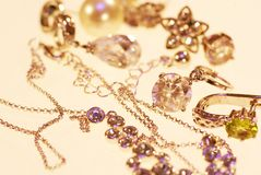 Photo of jewelery earrings and chains. Photo jewelry. rings of earrings and chains on a light background royalty free stock photo