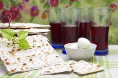 A photo of Jewish Matzah bread, boiled eggs, kosher red wine and a linden tree branch. Matzah for the Jewish Passover holidays. Se royalty free stock images