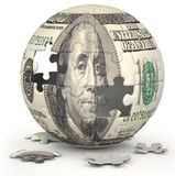 Dollar Globe. Photo of a jigsaw sphere image mapped with a 100 dollar bill on a white backdrop Royalty Free Stock Photography