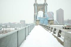 John A. Roebling Suspension Bridge in the winter snow in Cincin stock photos