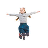 Photo of joyful little girl jumping Royalty Free Stock Image