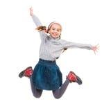 Photo of joyful little girl jumping Stock Photo